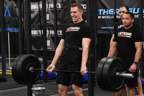 Jesse Emery performs a dead lift during the 'FitCon Frontline Throwdown' at the Salt Palace in Salt Lake City, Utah, April 21. The four-person team took turns lifting 225 pounds as many times as possible in 10 minutes. (R. Nial Bradshaw/U.S. Air Force)