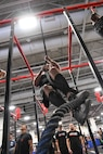Brandon Charleson performs climbs a rope during the 'FitCon Frontline Throwdown' at the Salt Palace in Salt Lake City, Utah, April 21. The four-person team took turns climbing the rope for 10 minutes. (R. Nial Bradshaw/U.S. Air Force)