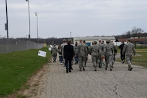 """110th Attack Wing members participate in a """"Walk-A-Mile"""" event on base as a show of support for those who have been affected by sexual asault and in conjunction with DoD's Annual Sexual Assault Awareness Month Thursday, April 13, 2017, Battle Creek Air National Guard Base, Mich. The walk preceded an information presentation in the Wellness Center Auditorium by Ms. Angela Tomasko, a Training Specialist with the Prosecuting Attorneys Association of Michigan (PAAM). Ms. Tomasko is a survivor of a sexual assault who has used her experience as a survivor to provide first-hand insight into the physical, mental, social and spiritual impacts of assault. Her story provides the valuable tools that can be used to support a friend, family member or wingman who may be living with the effects of sexual assault. (U.S. Air National Guard photo by Master Sgt. Sonia Pawloski/released)"""