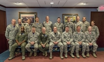 110th Attack Wing Commanders pose for a group photo at the Battle Creek Air National Guard Base, Mich., Friday, December 2, 2016. Pictured left to right (back) Col. Donald Henry, Col. Eric Ely, Col. Rey Regualos, Maj. Daniel Guy, Lt. Col. Daniel Kramer, Lt. Col. Josiah Meyers, Capt. Shawn Hatfield, Maj. Ryan Kristof, Capt. Ignacio Perez, Lt. Col. Lisa Berard, (Front) Col. Alexander, Col. John Miner, Col. Keir Knapp, Col. Bryan Teff, Chief Master Sgt. Trever Slater (Wing Command Chief), Col. Eric Oswald, Col. Kevin Bohnsack. (Air National Guard photo released by Master Sgt. Scott Thompson/Released)