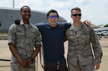 Jared Estes, a motivational speaker and survivor of burn injuries caused by a drunk driver, poses for a photo with Senior Airman Gregory Scott, 2nd Munitions Squadron, left, and Airman 1st Class Gregory Adams, 2nd MUNS, at Barksdale Air Force Base, La., April 14, 2016. After telling his resilience story of overcoming the fiery and painful aftermath of a drunken driving incident where his vehicle was hit by a driver who was moving at more than 100 miles per hour, he toured the B-52 Stratofortress and learned from Scott and Adams about its weapons systems. (U.S. Air Force photo/Staff Sgt. Benjamin Raughton)