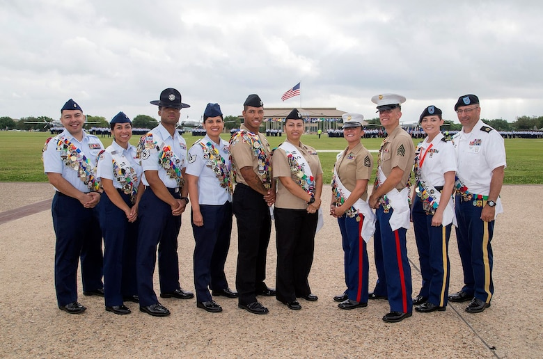 The Joint Base San Antonio Military Fiesta Ambassadors are pictured at the Air Force Basic Training Graduation Parade April. 21, 2017, at JBSA-Lackland. The servicemembers from each branch of the military across JBSA will represent their respective services at events associated with Fiesta San Antonio such as participating in parades, visiting schools and nursing homes and retirement facilities. Fiesta San Antonio is a 10-day celebration of military history to honor the life and memory of the members who died in the Battle of the Alamo and the Battle of San Jacinto. Beginning in 1891 as a one-day parade event, Fiesta San Antonio has evolved into a 10-day festival celebrating the heritage and history of San Antonio and the vast military community. (U.S. Air Force photo by Johnny Saldivar)