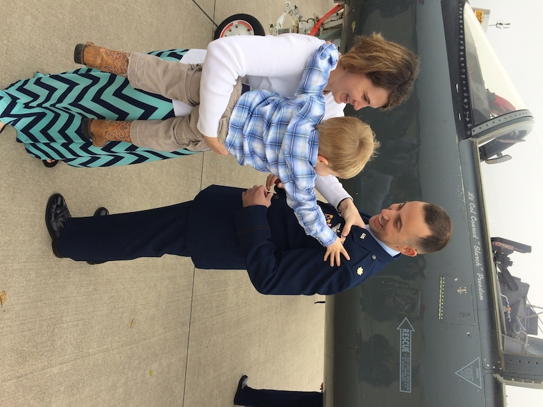 Maj. William 'Bubba' Pope's wife Necia and son Tyler pin on his wings on the flight line at Laughlin Air Force Base, Texas. (Courtesy photo).