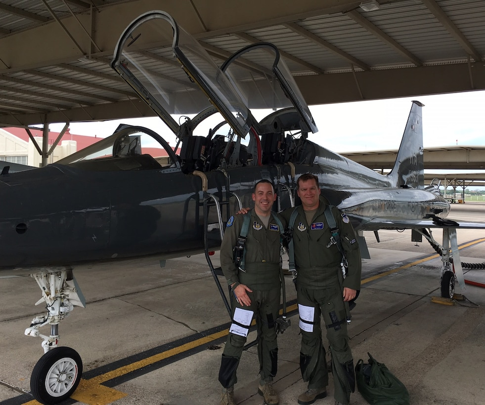 Maj. William 'Bubba' Pope (L) pauses for a photo with Lt. Col. Matthew 'MIG' Alley on the flight line at Laughlin Air Force Base, Texas. (Courtesy photo).