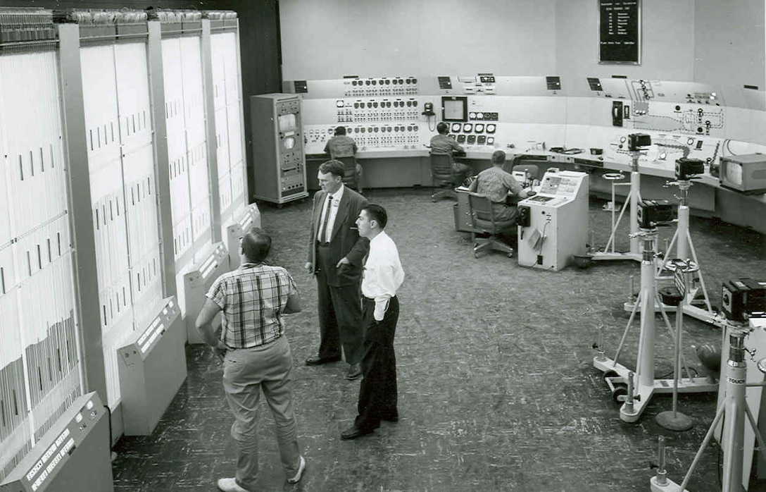 This 1957 photo of the Main Control Room-for the Propulsion Wind Tunnel's transonic circuit shows manometer banks at left, for recording pressures from the tunnel's test section. At the far rear is a closed-circuit television monitor which shows the test item on its screen. The tunnel's chief operator is seated in the center of the room. (AEDC photo)