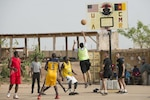 American and Cameroonian military members play in a friendly basketball game in Garoua, Cameroon, April 21, 2017. Task Force Toccoa, which is supporting Cameroon's efforts against Boko Haram, decided to hold the game for the first time to help build better cohesion between both militaries. Photo by Sean Kimmons