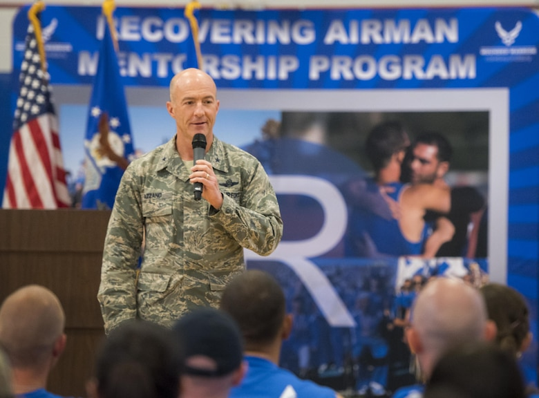 Brig. Gen. Christopher Azzano, the 96th Test Wing commander, speaks to the Warrior CARE attendees and Warrior Games athletes at the opening ceremony of the two events April 24 at Eglin Air Force Base, Fla. The ceremony kicked off a week-long rehabilitative wounded warrior camp as well as a training session for the Air Force Warrior Games athletes. (U.S. Air Force photo/Samuel King Jr.)