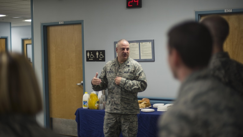 """Col. Paul Willingham, the 49th Medical Group commander, addresses a room of people during the MDG's Swab-Thru event, at Holloman Air Force Base, N.M. on April 20, 2017. The Swab-Thru, coordinated with the """"Salute to Life"""" program, is a special drive-thru bone marrow registration event. (U.S. Air Force photo by Airman 1st Class Alexis P. Docherty)"""
