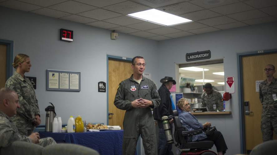 """Col. Houston Cantwell, the 49th Wing commander, addresses a room of people during the 49th Medical Group's Swab-Thru event, at Holloman Air Force Base, N.M. on April 20, 2017. The Swab-Thru, coordinated with the """"Salute to Life"""" program, is a special drive-thru bone marrow registration event. """"Salute to Life"""" works solely with military personnel, their dependents, civilians and contract employees, Reservists, Coast Guard and National Guard members, to facilitate bone marrow and stem cell donations. (U.S. Air Force photo by Airman 1st Class Alexis P. Docherty)"""