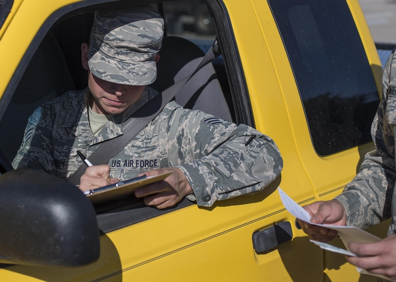 """Senior Airman Bryce Bigboy, a 49th Material Maintenance Squadron metals technician, fills out a consent form during the 49th Medical Group's Swab-Thru event, at Holloman Air Force Base, N.M. on April 20, 2017.  The Swab-Thru, coordinated with the """"Salute to Life"""" program, is a special drive-thru bone marrow registration event. (U.S. Air Force photo by Airman 1st Class Alexis P. Docherty)"""