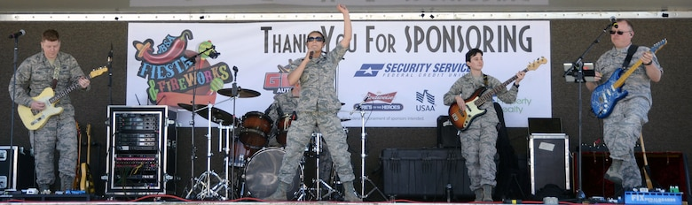 Members of the U.S. Air Force band of the West get their groove on for the crowd at the Fiesta and Fireworks event at Joint Base San Antonio-Fort Sam Houston April 23.