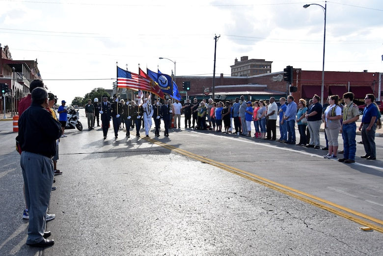 The Goodfellow Joint Service Color Guard marches at the Downtown Stroll on the corner of South Oakes St. and Concho Ave. in San Angelo, Texas, April 20, 2017. Downtown San Angelo hosted the event to celebrate local first responders and military personnel. (U.S. Air Force photo by Staff Sgt. Joshua Edwards/Released)