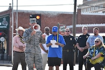 U.S. Air Force Col. Michael Downs, 17th Training Wing Commander, speaks at the Downtown Stroll on the corner of South Oakes St. and Concho Ave. in San Angelo, Texas, April 20, 2017. Downs thanked everyone for their support to the military. (U.S. Air Force photo by Staff Sgt. Joshua Edwards/Released)