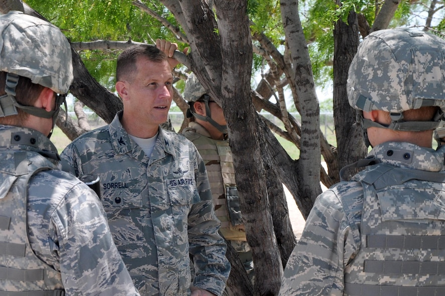 U.S. Air Force Col. Jeffrey Sorrell, 17th Training Wing Vice Commander, visits Angelo State University Air Force ROTC Detachment 847 cadets during a field training exercise at Camp Sentinel on Goodfellow Air Force Base, Texas, April 21, 2017. The FTX lasted more than 24 hours and tested the cadet's leadership capabilities. (U.S. Air Force photo by Christopher Hernandez/Released)