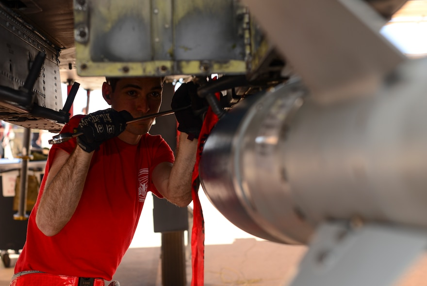 U.S. Air Force Airman 1st Class Alexander Evans, 924th Aircraft Maintenance Unit load crew team member, secures a Guided Bomb Unit-38 onto an A-10C Thunderbolt II during a load crew of the quarter competition at Davis-Monthan Air Force Base, Ariz., April 21, 2017. Three teams competed against each other to determine which one could load munitions onto an A-10 with minimal errors in the least amount of time possible. (U.S. Air Force photo by Airman 1st Class Nathan H. Barbour)