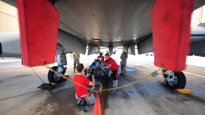 U.S. Airmen, assigned to the 924th Aircraft Maintenance Unit, load a Guided Bomb Unit-38 onto an A-10C Thunderbolt II during a load crew of the quarter competition at Davis-Monthan Air Force Base, Ariz., April 21, 2017. The quarterly events allow Airmen to exhibit their teamwork on a competitive platform, while providing conditions to spark the sense of urgency and attention to detail that are imperative for Airmen to destroy enemies downrange. (U.S. Air Force photo by Airman 1st Class Nathan H. Barbour