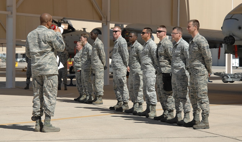 U.S. Air Force Chief Master Sgt. Theodis Bell, 355th Maintenance Group weapons manager, addresses three weapons teams before a load crew of the quarter competition at Davis-Monthan Air Force Base, Ariz., April 21, 2017. The three competing teams were the 354th, 357th and the 924th aircraft maintenance units. (U.S. Air Force photo by Airman 1st Class Frankie D. Moore)