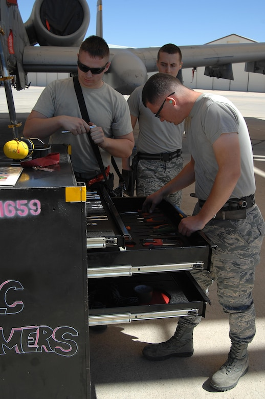 U.S. Air Force Staff Sgt. Christopher Ouellet, Airman 1st Class Erik Wiley and Zachary Rhodes, 357th Aircraft Maintenance Unit load crew team members, check tool accountability before a load crew of the quarter competition at Davis-Monthan Air Force Base, Ariz., April 21, 2017. Airmen from each load crew team were handpicked by their leadership to participate in the competition. (U.S. Air Force photo by Airman 1st Class Frankie D. Moore)