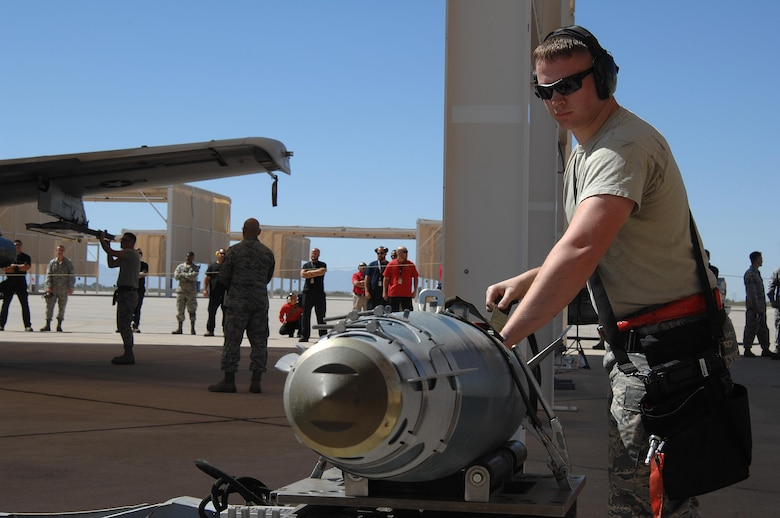 U.S. Air Force Staff Sgt. Christopher Ouellet, 357th Aircraft Maintenance Unit weapons load crew team member, secures a Guided Bomb Unit-38 to be loaded onto an A-10C Thunderbolt II during a load crew of the quarter competition at Davis-Monthan Air Force Base, Ariz., April 21, 2017. The quarterly events allow Airmen to exhibit their teamwork on a competitive platform, while providing conditions to spark the sense of urgency and attention to detail that are imperative for Airmen to destroy enemies downrange. (U.S. Air Force photo by Airman 1st Class Frankie D. Moore)