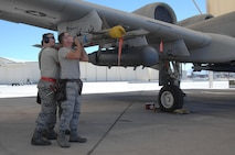 U.S. Air Force Staff Sgt. Christopher Ouellet, Airman 1st Class Erik Wiley and Zachary Rhodes, 357th Aircraft Maintenance Unit weapons load crew team members, load an AIM-9 Sidewinder missile onto an A-10C Thunderbolt II during a load crew of the quarter competition at Davis-Monthan Air Force Base, Ariz., April 21, 2017. The load crews were required to complete their assigned tasks in accordance with their technical orders in the least amount of time possible. (U.S. Air Force photo by Airman 1st Class Frankie D. Moore)