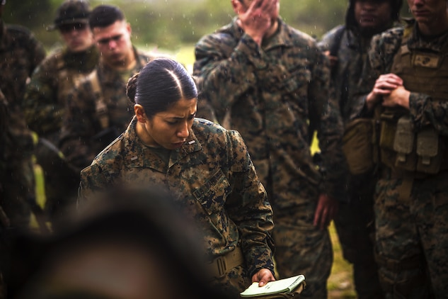 2nd Lt. Jennifer N. Galvan gives a mission brief during a Marine Corps Combat Readiness Evaluation at Central Training Area, Camp Hansen, Okinawa, Japan, April 18, 2017. 3d Law Enforcement Battalion conducted the evaluation to test each company's ability to execute tasks ranging from policing operations to police patrolling, route regulations, key leader engagements in towns and local population centers, and security of key infrastructure in an expeditionary environment, to ensure they are prepared to support the operational requirements of III Marine Expeditionary Force. Galvan, a native of Oak Lawn, Ill., is a platoon commander for Bravo Company, 3d LE Bn., III MEF Headquarters Group. (U.S. Marine Corps photo by Lance Cpl. Joshua Pinkney)