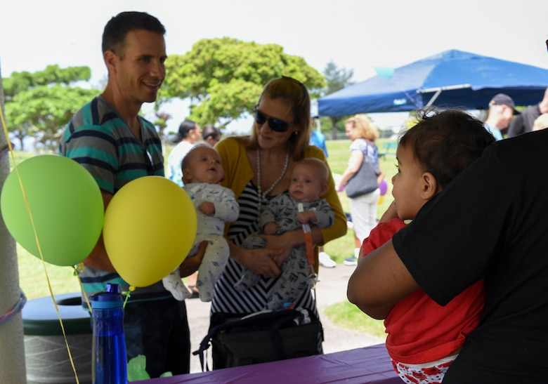 Families who received support from Camp Foster's Neonatal Intensive Care Unit participate in the NICU's annual reunion April 23, 2017, at Kadena Air Base, Japan. Camp Foster's NICU provides around-the-clock care for newborn infants on Okinawa, as well as those at other Pacific Air Forces locations whose needs can't be met by facilities at their home base. (U.S. Air Force photo by Senior Airman John Linzmeier)