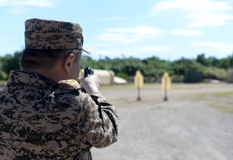 A Mongolian Air Force service member aims a M9 Beretta during the firing portion of Pacific Defender 17-1, April 11, 2017, at Andersen Air Force Base, Guam. Pacific Defender, is designed to establish integrated defensive cooperation with Indo-Asia-Pacific nations, while promoting regional stability and military relations. (U.S Air Force photo by Airman 1st Class Gerald R. Willis/Released)