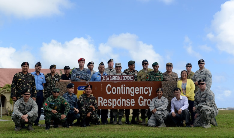 Service members from eight different countries pose for a group photo near the 36th Contingency Response Group after completion of Pacific Defender 17-1, April 14, 2017, at Andersen Air Force Base, Guam. Pacific Defender is a Pacific Air Forces led exercise that focuses on subject-matter expert exchanges designed to increase partner capabilities. (U.S Air Force photo by Airman 1st Class Gerald R. Willis/Released)