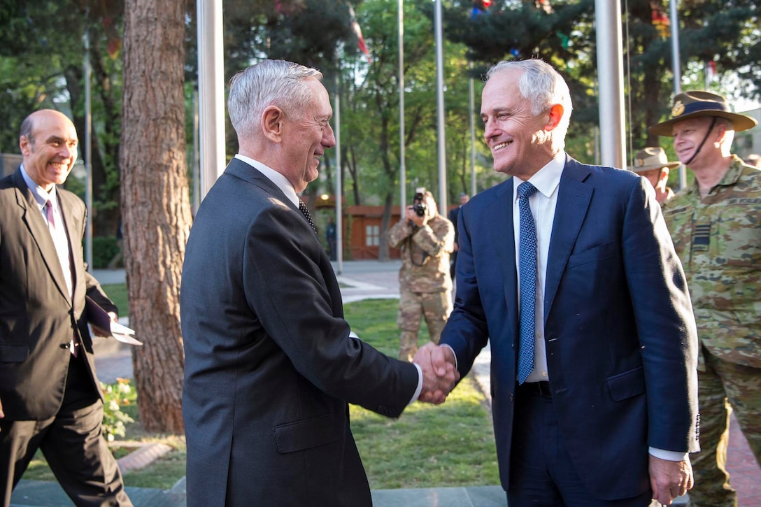 Defense Secretary Jim Mattis shakes hands with Australian Prime Minister Malcolm Turnbull