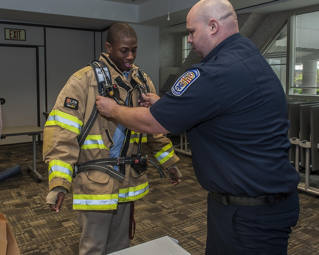 Local students tried on firefighter gear and learned about what it means to be a DLA firefighter during a mini career fair held on Apr. 20 at DSCC.