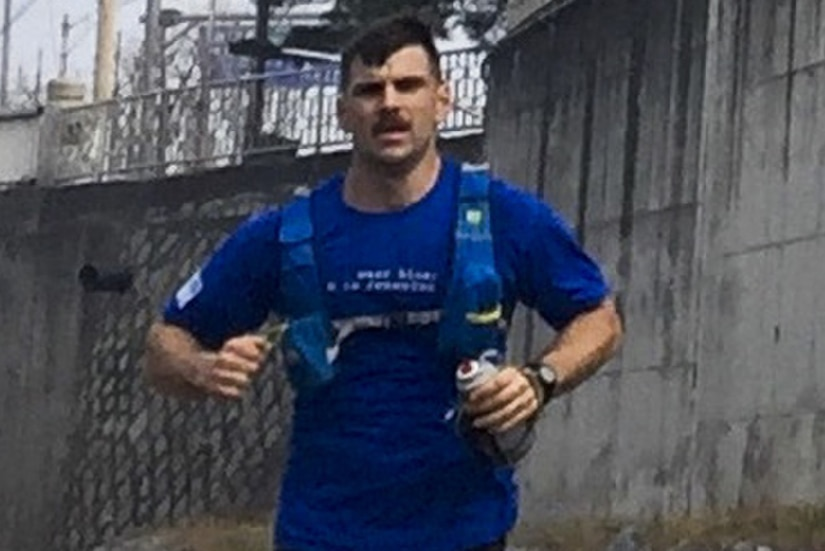 """Army Capt. Brandon Carius, a physician assistant from 1st Battalion, 5th Field Artillery Regiment, demonstrated his """"fight-tonight"""" readiness by running about 42 miles from Camp Hovey to Yongsan district, Seoul, South Korea, April 8, 2017. Army photo"""