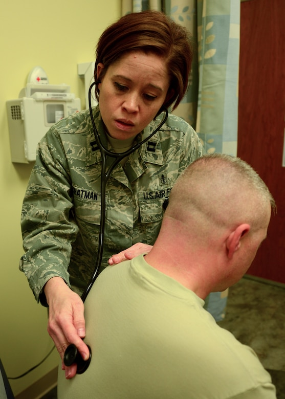 U.S. Air Force Capt. (Dr.) Eva Chatman, 20th Medical Group family health physician, checks a patient's vitals at Shaw Air Force Base, S.C., April 19, 2017. Chatman is responsible for providing health care to service members to ensure they can complete their mission. (U.S. Air Force photo by Airman 1st Class Kathryn R.C. Reaves)