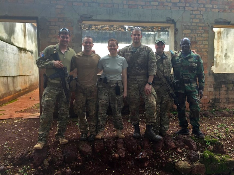 U.S. Air Force Capt. (Dr.) Eva Chatman, 20th Medical Group family health physician, center, stands with others during her deployment at an undisclosed location in Africa circa 2016. During the deployment, Chatman was responsible for the care of approximately 250 service members and federal employees. (Courtesy photo)