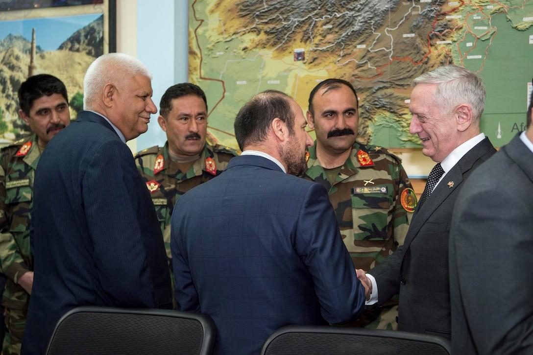 Defense Secretary Jim Mattis speaks with Afghan Minister of Interior Affairs Mohammad Jahid and Afghan Minister of Defense Abdullah Habibi