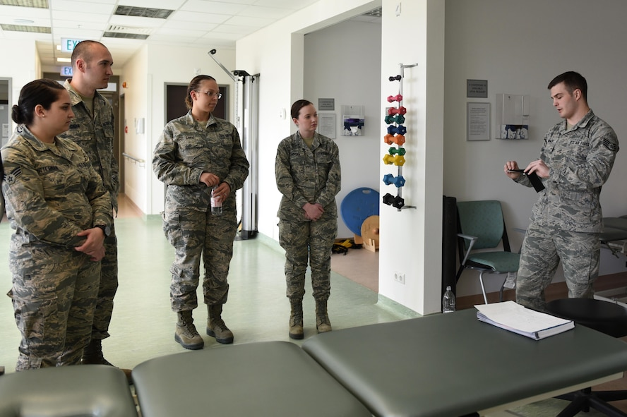 Staff Sgt. Daniel Dunwald, 52nd Medical Operations Squadron physical therapy technician and certified kinesio tape practitioner, teaches others the benefits of using k-tape during the recent medical group training day at Spangdahlem Air Base, Germany, April 20, 2017. Kinesio taping is a procedure intended to decrease pain and inflammation, stimulate blood and lymph circulation, aid postural correction, enhance athletic performance and prevent musculoskeletal injuries. (U.S. Air Force photo by Tech. Sgt. Staci Miller)