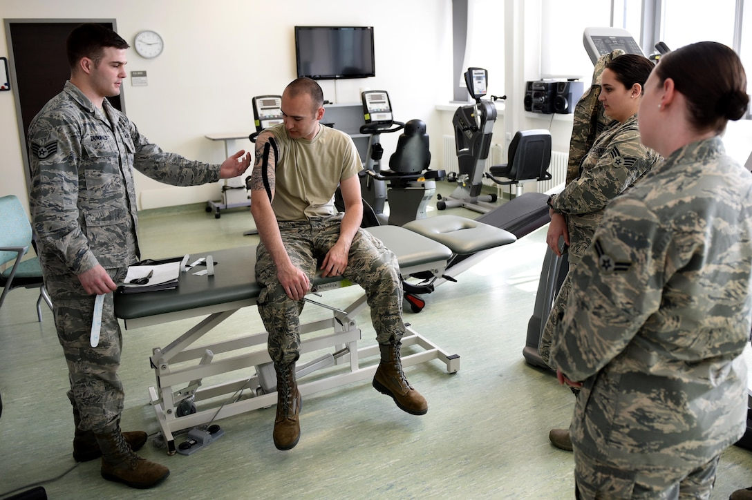 Staff Sgt. Daniel Dunwald, 52nd Medical Operations Squadron physical therapy technician and certified kinesio tape practitioner, teaches others the benefits of using k-tape during the recent medical group training day at Spangdahlem Air Base, Germany, April 21, 2017. Kinesio taping is a procedure intended to decrease pain and inflammation, stimulate blood and lymph circulation, aid postural correction, enhance athletic performance and prevent musculoskeletal injuries. (U.S. Air Force photo by Tech. Sgt. Staci Miller)