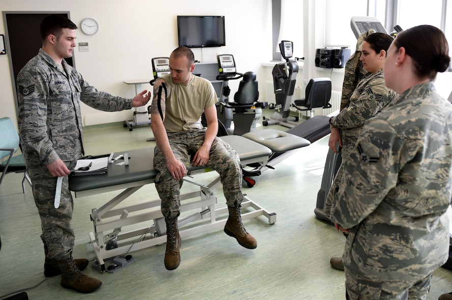 Staff Sgt. Daniel Dunwald, 52nd Medical Operations Squadron physical therapy technician and certified kinesio tape practitioner, teaches others the benefits of using k-tape during the recent medical group training day at Spangdahlem Air Base, Germany, April 21, 2017. Kinesio taping is a procedure intended to decrease pain and inflammation, stimulate blood and lymph circulation, aid postural correction, enhance athletic performance and