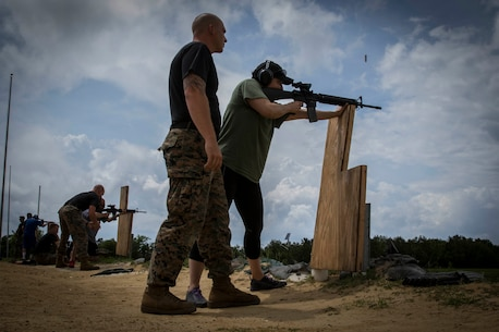 High school and college educators engage targets at the unknown distance range during the live-fire portion of the Educators' Workshop on Marine Corps Recruit Depot Parris Island, S.C., April 20, 2017. The workshop is a four-day program designed to better inform high school and college educators from Maine, New Hampshire, Vermont and Massachusetts about the benefits and opportunities available during service in the Marine Corps. This allows the attendees to return to their place of business and provide firsthand experience and knowledge with individuals interested in military service. (Official Marine Corps photo by Staff Sgt. Jonathan G. Wright / Released)
