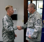 Lt. Col. Nathan Leap, Community College of the Air Force Commandant, presents Senior Master Sgt. Duane Caudill, 302nd Maintenance Group career advisor, with his CCAF degree on Maxwell Air Force Base, Ala., April 21, 2017. Caudill is the 500,000th graduate of the CCAF. It only took Caudill six months to complete the final steps of reaching his goals and obtaining his CCAF degree. (U.S. Air Force photo/Senior Airman Tammie Ramsouer)
