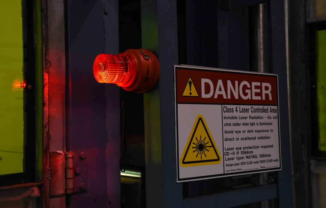 A danger sign and beacon simulate real safety precautions taken during laser operations at Travis Air Force Base, Calif., April 10, 2017. Travis AFB was selected as one of the first bases to test the new Nd:YAG lasers for paint, primer, corrosion and rust removal. (U.S. Air Force photo by Senior Airman Sam Salopek)