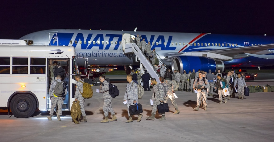 Returning airmen deplane at Mountain Home Air Force Base, Idaho, April 22, 2017. More than 100 airmen assigned to the 726th Air Control Squadron returned from a six-month deployment to locations throughout Southwest Asia. They provided theater command and control for air operations in one of the most complicated airspaces in Air Force history. (U.S. Air Force photo/Staff Sgt. Samuel Morse)
