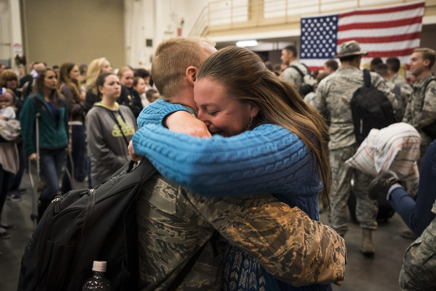 Capt. Torrance Barach, 726th Air Control Squadron, reunites with his wife at Mountain Home Air Force Base, Idaho, April 22, 2017. The 726th ACS set up tables, games, food and movies for the families waiting for their loved ones. (U.S. Air Force photo/Staff Sgt. Samuel Morse)