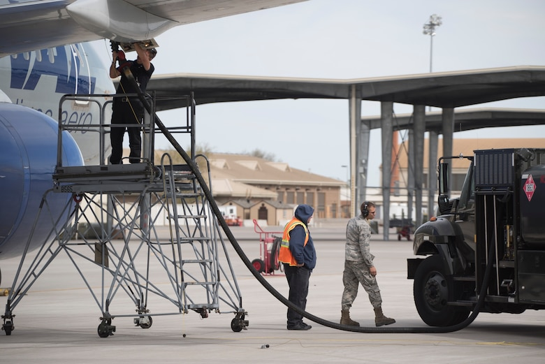 Crews refuel a charter aircraft at Mountain Home Air Force Base, Idaho, April 22, 2017. The 366th Logistics Readiness Squadron and other support agencies make sure the aircrew have what they need no matter where the aircraft comes from. (U.S. Air Force photo/Staff Sgt. Samuel Morse)