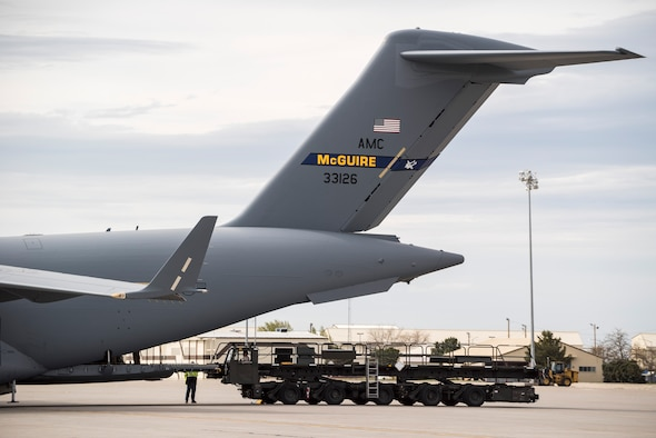 Airmen from the 366th Logistics Readiness Squadron prepare a K-loader to unload a C-17 Globemaster III at Mountain Home Air Force Base, Idaho, April 22, 2017. The aircraft was carrying equipment used by 389th Fighter Squadron airmen recently returned from a six-month deployment to Southwest Asia. (U.S. Air Force photo/Staff Sgt. Samuel Morse)