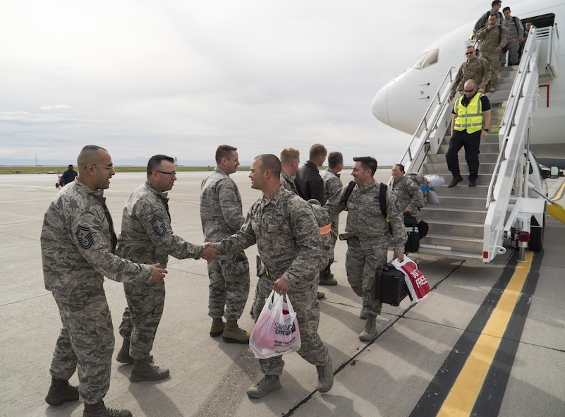 Base leadership welcome home deployers from the 726th Air Control Squadron at Mountain Home Air Force Base, Idaho, April 22, 2017. Despite the two flights being spaced 12 hours apart and challenging weather, the commanders and senior NCOs came out to give the deployers a proper homecoming. (U.S. Air Force photo/Staff Sgt. Samuel Morse)