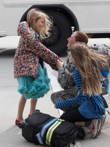A family reunites at Mountain Home Air Force Base, Idaho, April 22, 2017. More than 100 airmen assigned to the 726th Air Control Squadron returned from a six-month deployment to locations throughout Southwest Asia. The 726th ACS is one of only three active duty control squadrons in the Air Force. (U.S. Air Force photo/Staff Sgt. Samuel Morse)