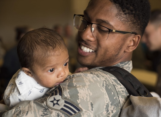 Senior Airman Aaron Wilson, holds his son, Adrian, for the first time at Mountain Home Air Force Base, Idaho, April 22, 2017. Adrian, two months old, was born while Wilson was deployed to Southwest Asia for six months. (U.S. Air Force photo/Staff Sgt. Samuel Morse)