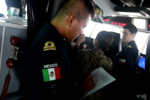 GULF OF PANAMA (Sept. 23, 2016) - Lt. j.g. Pedro Cortes, of Mexico, goes over navigational formations on board USNS Spearhead (T-EPF 1) for a multi-national ship formation during UNITAS 2016. UNITAS is an annual multi-national exercise that focuses on strengthening our existing regional partnerships and encourages establishing new relationships through the exchange of maritime mission-focused knowledge and expertise throughout the exercise. (U.S. Navy Photo by Mass Communication Specialist 1st Class Jacob Sippel/RELEASED)