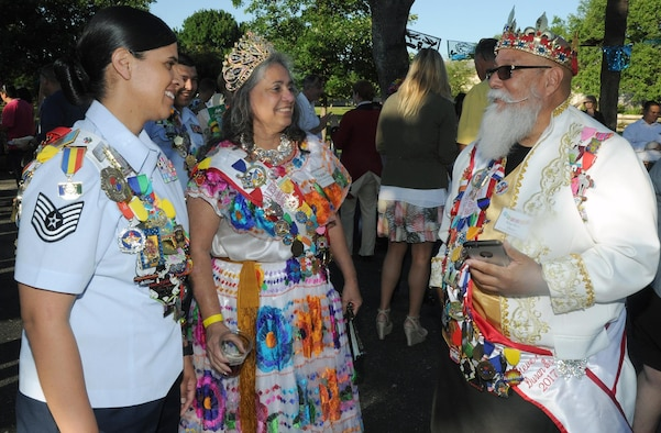 El Rey de Barrio King Steve Duran (right) chats with Queen Virginia Duran (center) and Joint Base San Antonio Air Force Ambassador Tech. Sgt. Marie Sarabia (left) during a reception at JBSA-Fort Sam Houston April 23.