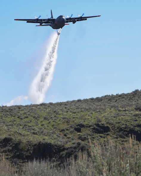 A C-130 Hercules loaded with the MAFFS (Modular Airborne Fire Fighting System) from the 152nd Airlift Wing of Reno, Nevada drops a water line while training to contain wildfires outside Boise, Idaho. April 21, 2017. More than 400 personnel of four C-130 Guard and Reserve units — from California, Colorado, Nevada and Wyoming, making up the Air Expeditionary Group — are in Boise, Idaho for the week-long wildfire training and certification sponsored by the U.S. (U.S. Air National Guard photo by Staff Sgt. Nieko Carzis)